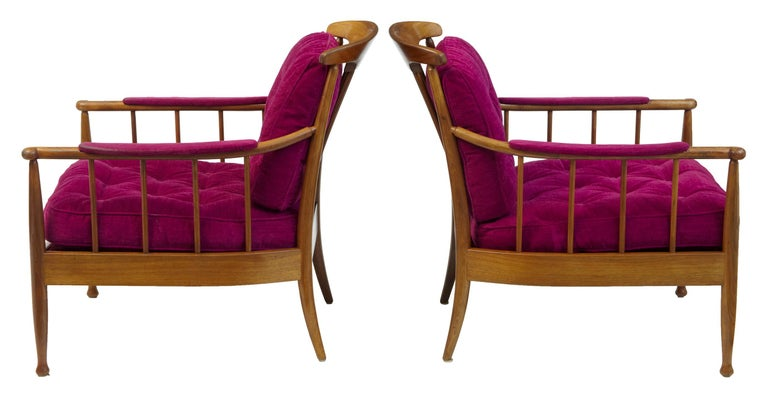 Iconic pair of chairs designed by Kerstin Horlin-Holmquist, circa 1963. Made by ope with their stamps on each chair. Made in beech, colored to walnut. Striking purple button back uphostery. Minor wear to arms.  Measures: Height: 31