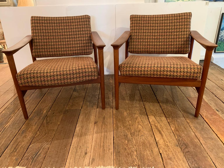 Sophisticated vintage Danish Mid-Century Modern club chairs having sleek teak frames, newly restored, and updated wool houndstooth upholstery. Attributed to Grete Jalk France and Son but no label. Seat height 17.
