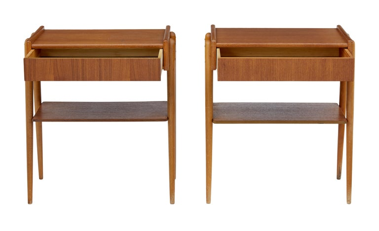 Pair of Danish teak bedside tables, circa 1960.  Single drawer to the front, which opens from the bottom so not to spoil the design. Solid teak leg frames which allows a single shelf to fit between the legs.  Minor surface marks and fading to