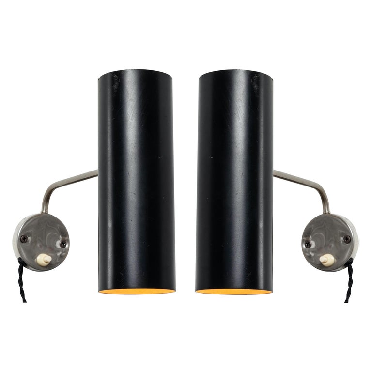 Pair of 1960s Tito Agnoli wall lights for O-Luce. An extremely rare matched pair executed in black painted aluminum and nickeled metal. One of his most highly refined Minimalist designs. A highly adjustable wall light, the arms can be rotated