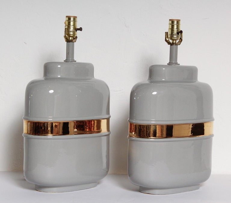 Simple and chic 1970s American ceramic lamps glazed in warm grey and 24-karat gold.