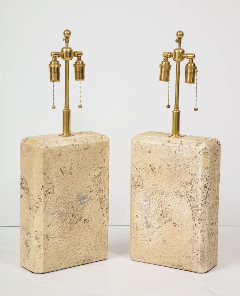 Pair of 1970s ceramic lamps with a Travertine textured finish.