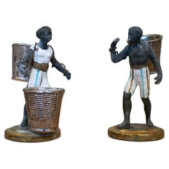 Pair of 1970s French Man and Woman Cast Aluminium Figure Statues