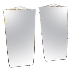 Pair of 1970s Italian Brass Framed Mirrors with Undulating Brass Detail at Top