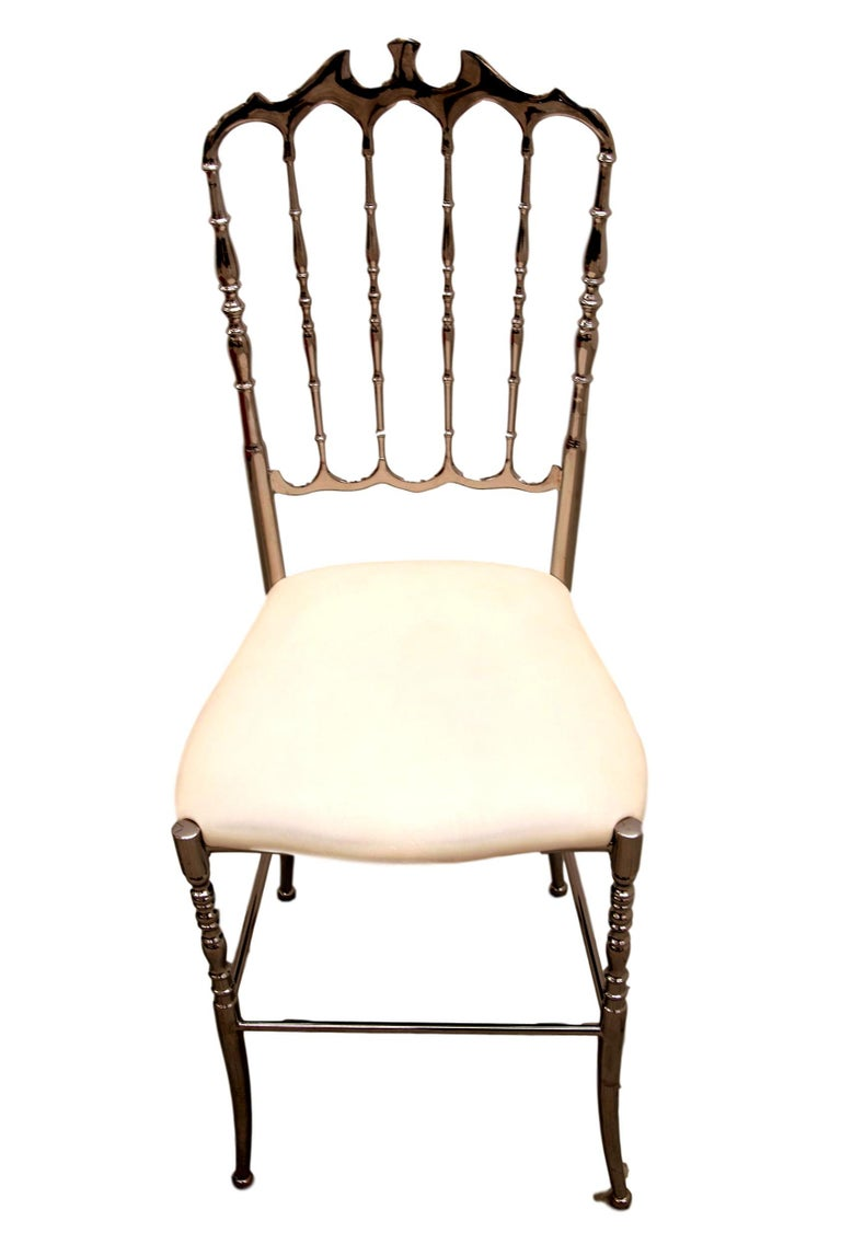 Pair of 1970s Italian Chiavari chairs with great vintage patina and perfect long lasting solid structure. The actual white and red upholstery is in good condition but can be renewed to customers' preference.  Chiavari chairs are named after the