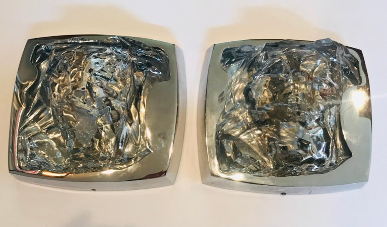 A luxurious pair of 1970s Austrian Space Age thick ice crystal and polished chrome wall lights. Standard 120 watt A socket. Rewired.