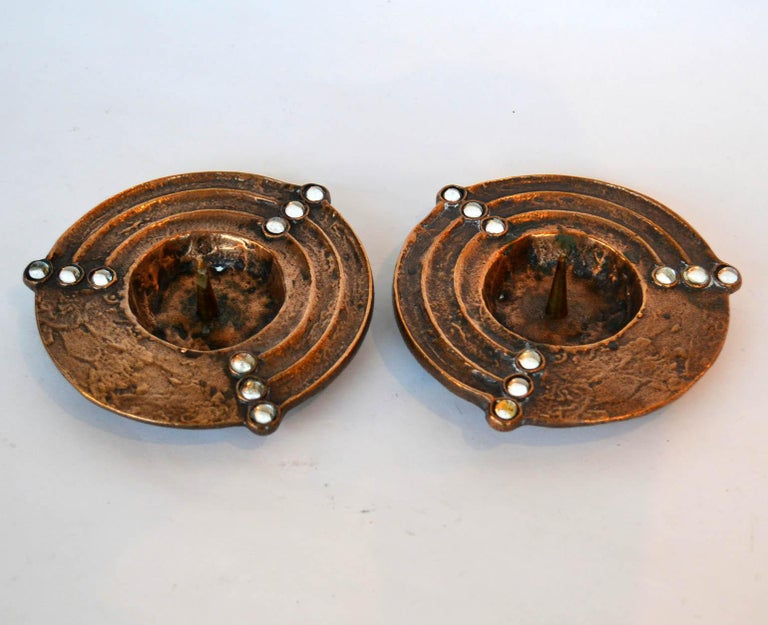 Bronze cast pair of round low candleholders decorated with pearl pattern, suitable for 4-5 cm wide candle.