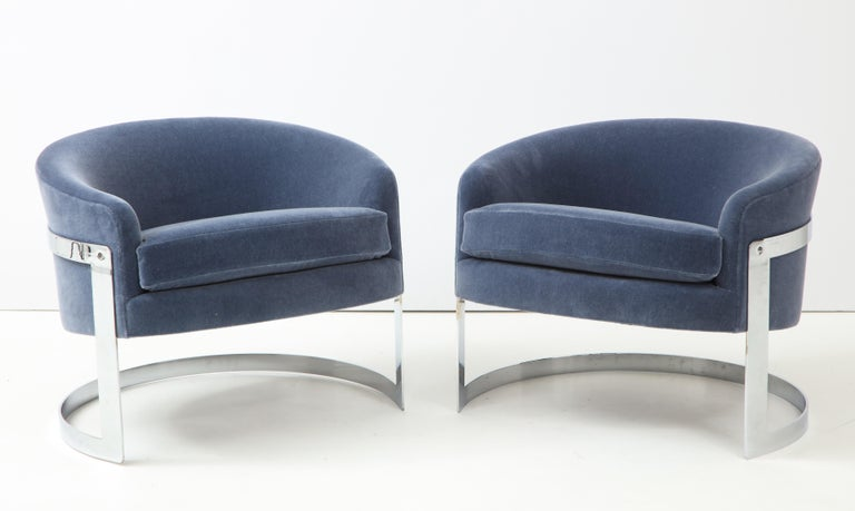 Pair of 1970s Milo Baughman club chairs. The chairs have been beautifully reupholstered in a luxurious dusky blue / gray mohair fabric. The chrome frames are in great vintage condition consistent with age.
