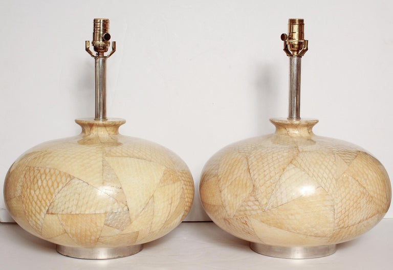 Rare and unusual 1970s pair of Karl Springer style lamps in lacquered fish leather. Shades are not included. Height measurement below is to top of socket.