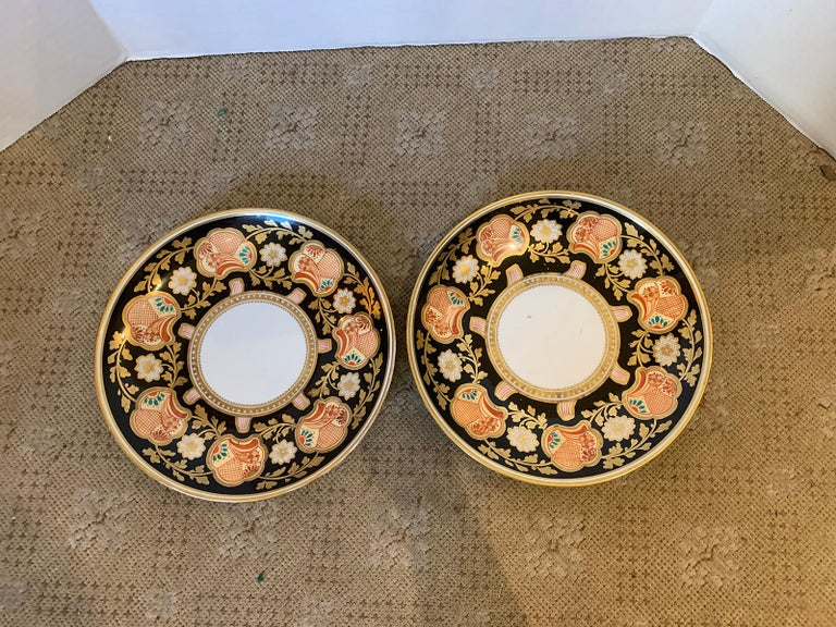 Pair of 19th-20th century English Porcelain dinner plates, black with gilt details, unmarked.