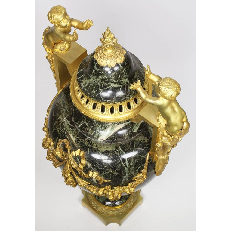 Pair of 19th-20th Century Louis XVI Style Ormolu and Marble Urns with Children For Sale 4