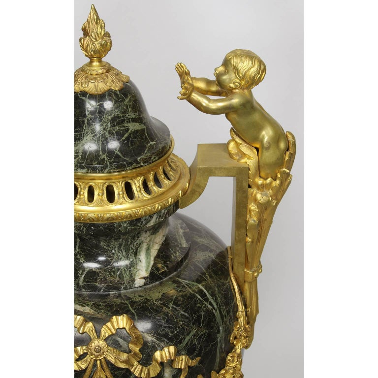 Bronze Pair of 19th-20th Century Louis XVI Style Ormolu and Marble Urns with Children For Sale