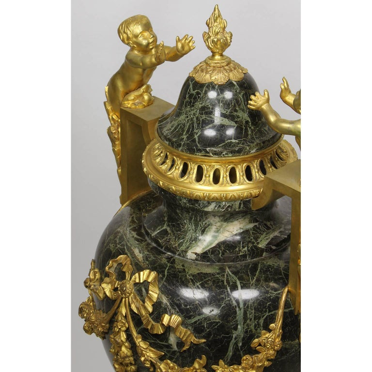 Pair of 19th-20th Century Louis XVI Style Ormolu and Marble Urns with Children For Sale 1