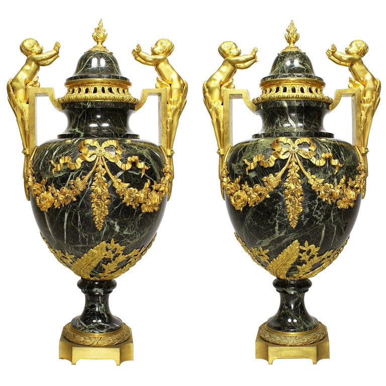 Pair of 19th-20th Century Louis XVI Style Ormolu and Marble Urns with Children For Sale