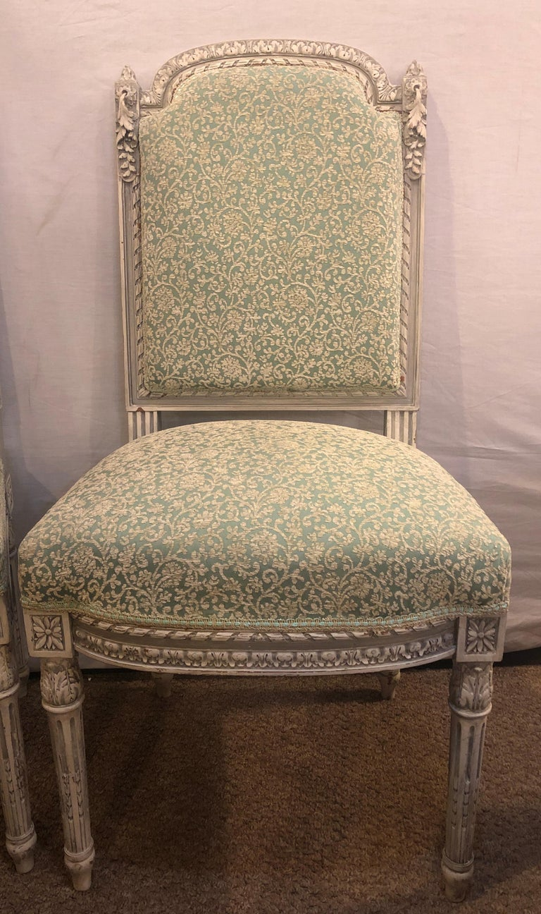 Pair of 19th-20th century paint decorated Louis XVI style Swedish side chairs. This fine pair of French Louis XVI style side chairs are stunning and the quality of the carvings and paint is unsurpassed. The simply breathtaking wood work certainly