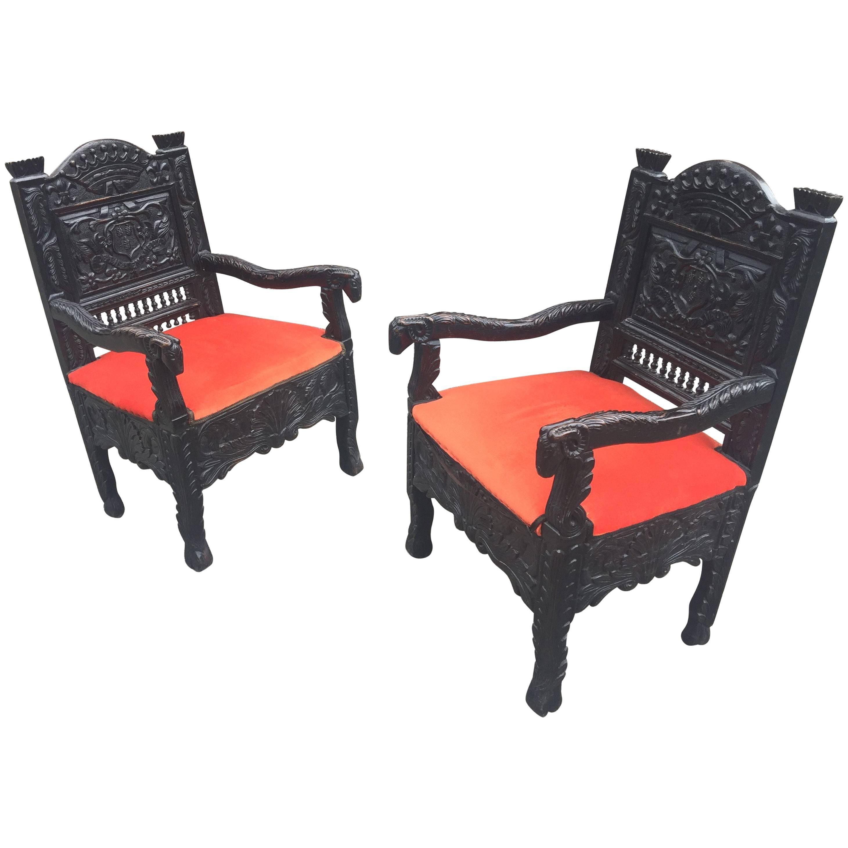 Pair of 19th Breton Chestnut Oak Armchairs with Head Ram Design