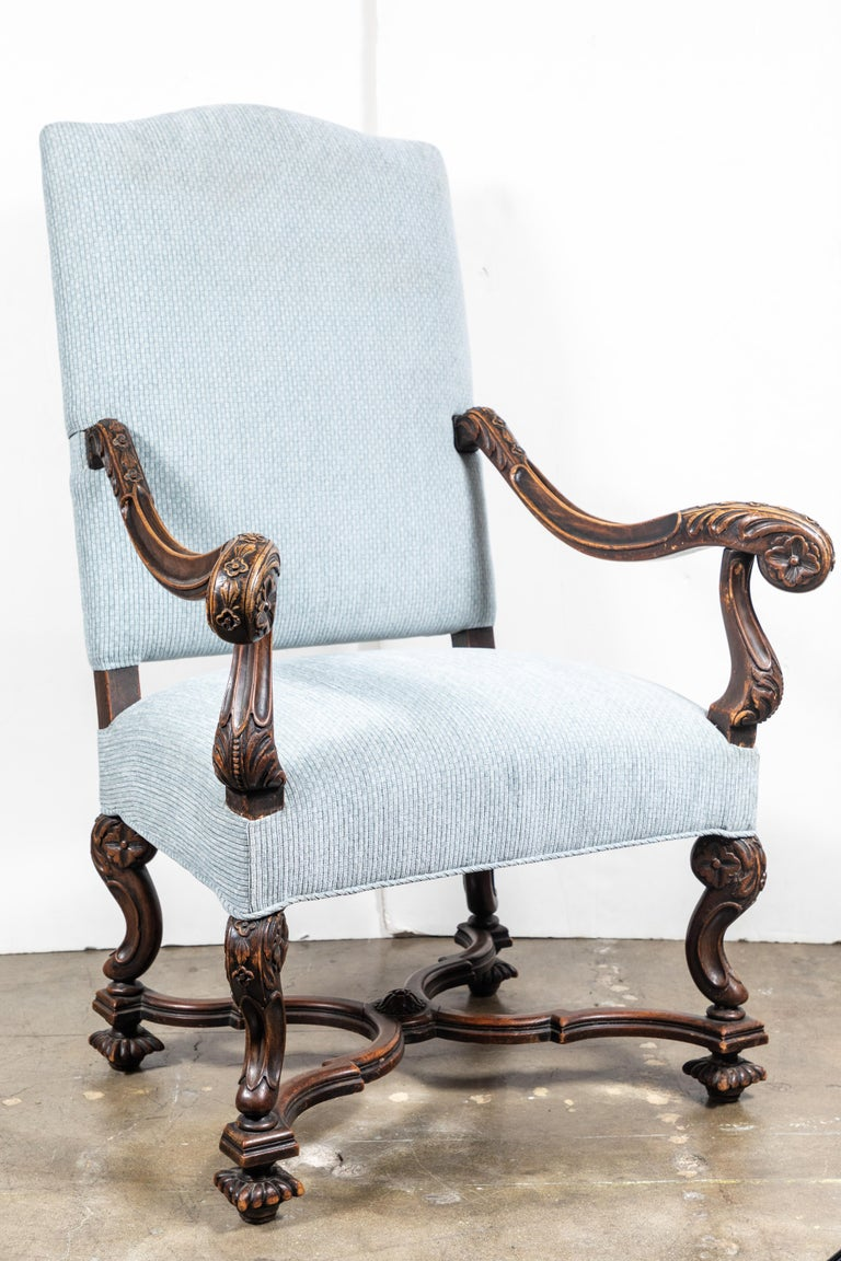 Pair of circa 1850, Italian, walnut armchairs with scrolling, foliate-embellished, splayed armrests above serpentine x-stretchers. Each in contemporary, checked, steel-blue silk velvet upholstery.