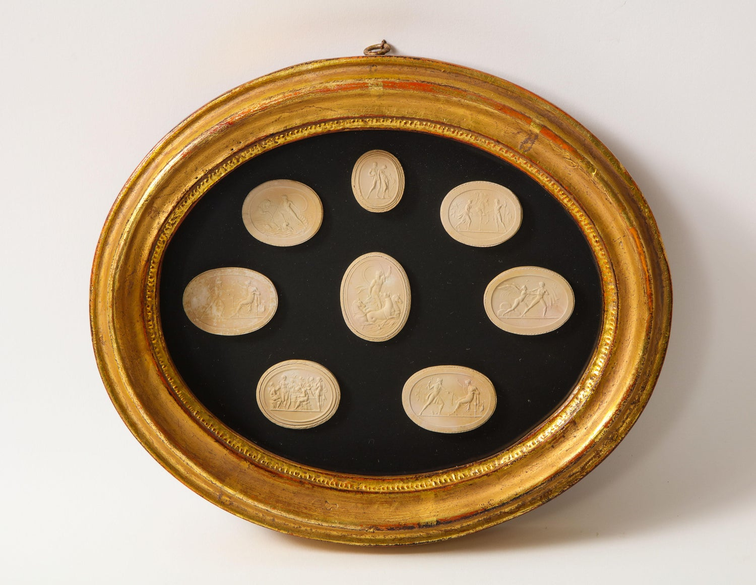 Framed Reproduction Grande Tour Intaglios mounted on  Italian endpaper in vintage round Italian Creamy white gilt frame