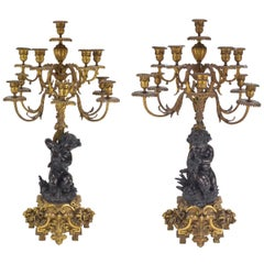 Pair of 19th Century Patinated and Gilt Bronze Candelabra Representing Fauns