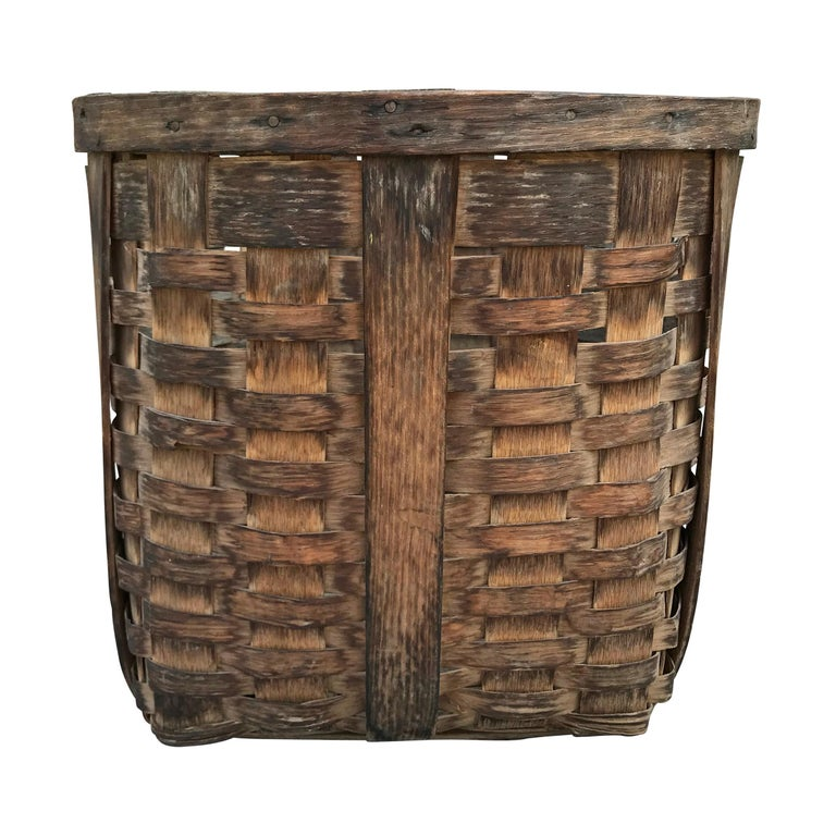A lovely pair of 19th century American handwoven oak splint potato gathering baskets, found in Northern Michigan, with wonderful patina, each with two handles and wide straps sturdy enough to support the weight of a basket full of potatoes. The