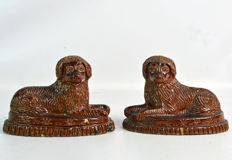 A wonderful matched pair of American mid-19th century yellow ware spaniels on oval decorated bases. Could be Virginia or Pennsylvania.