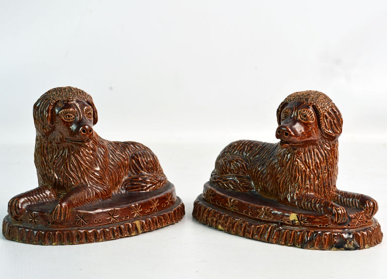 Folk Art Pair of 19th Century American Yellow Ware Recumbent Spaniels on Oval Plinths For Sale