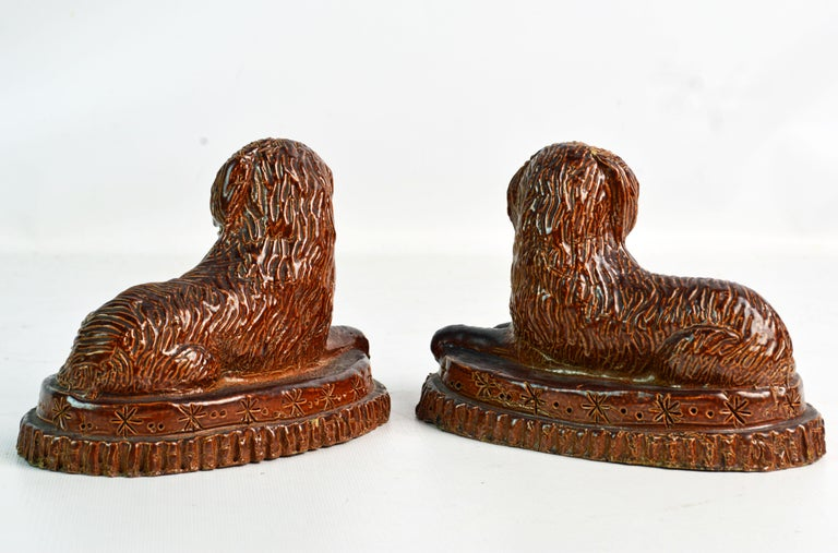 Glazed Pair of 19th Century American Yellow Ware Recumbent Spaniels on Oval Plinths For Sale
