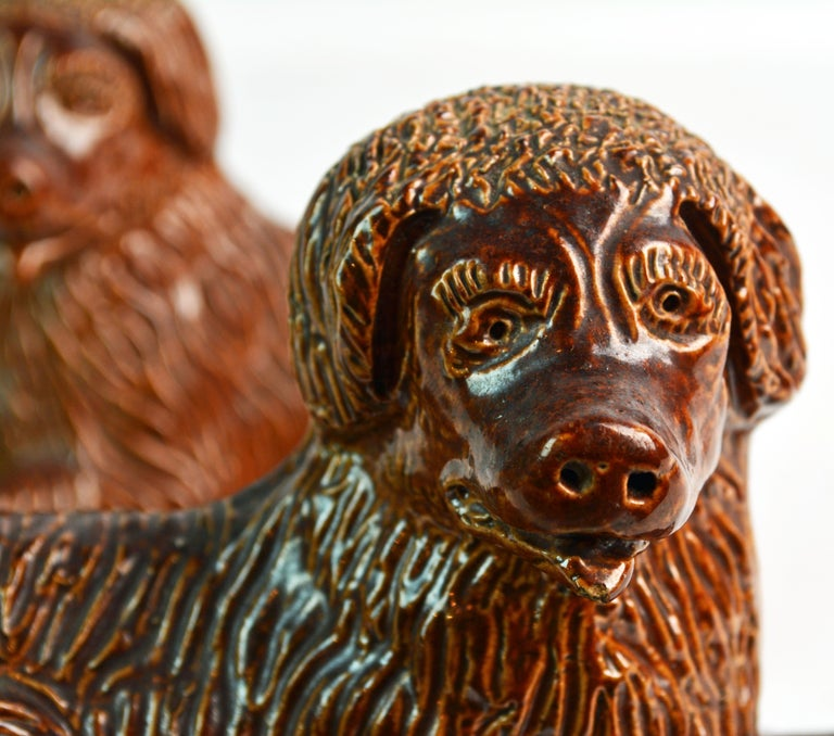 Stoneware Pair of 19th Century American Yellow Ware Recumbent Spaniels on Oval Plinths For Sale