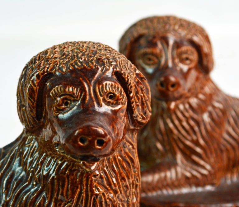 Pair of 19th Century American Yellow Ware Recumbent Spaniels on Oval Plinths For Sale 1