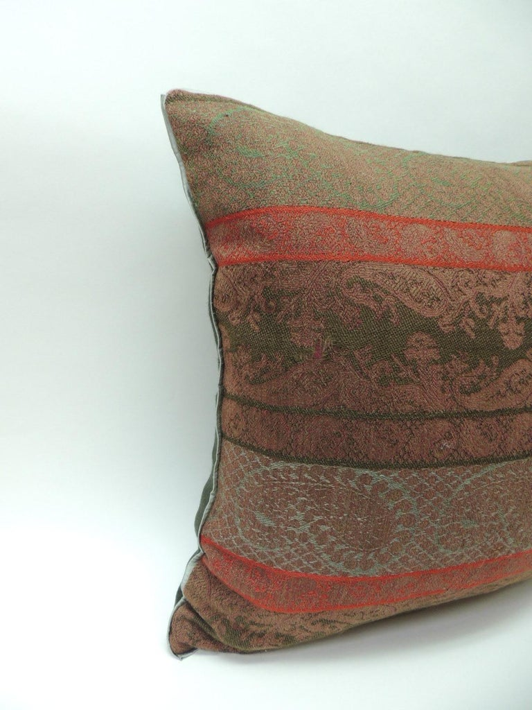 Pair of 19th century antique woven red and green Kashmir horizontal stripes decorative pillows with green flat green silk trim and hunter green carriage cloth fabric backing. In shades of brown, green, red and soft green. Handcrafted decorative