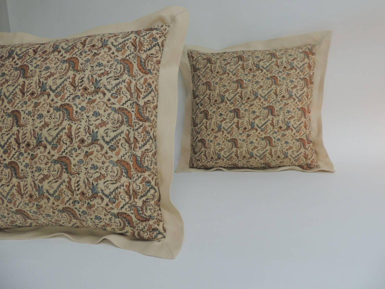 Pair of Arts & Crafts square floral printed linen decorative pillows with A.T.G. custom linen flange. Throw pillows handcrafted with a 19th century textile in shades of soft yellow linen same as backing. Color palette in the antique yellow textile