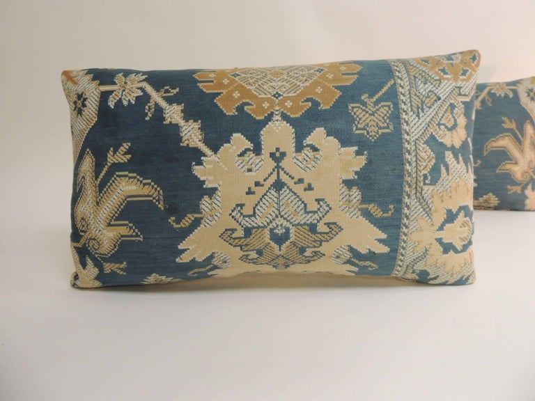 Pair of 19th century Arts & Crafts tan and blue decorative lumbar pillows Pair of vintage 19th century Arts & Crafts decorative lumbar pillows handcrafted with a tan and blue textile. Pair of woven floral pillows (tapestry) like textile. Decorative