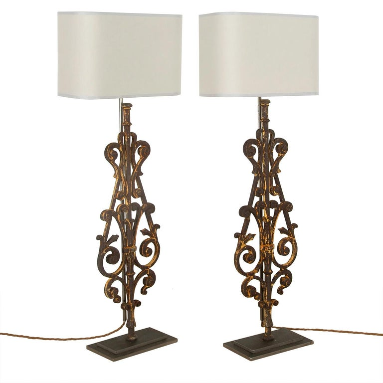 A decorative pair of lamps made in our artisan work shops using fragments of 19th century iron balustrade. This piece has been rewired and PAT tested to UK standards.
