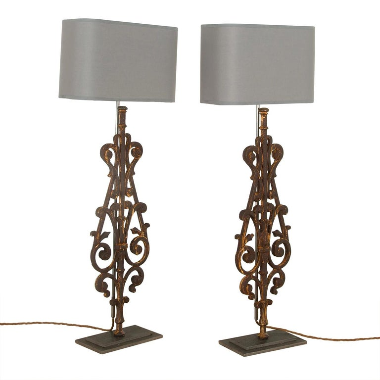A decorative pair of lamps made in our artisan work shops using fragments of 19th century iron balustrade. This pieces has been rewired and PAT tested to UK standards.