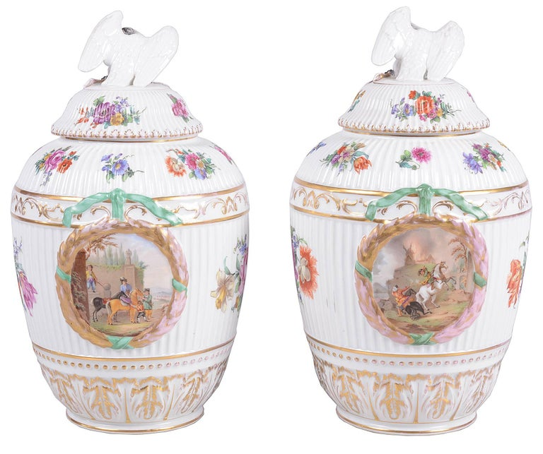 A good quality pair of 19th century Berlin porcelain lidded vases. Each with Swan finials to the lids, floral decoration and panels depicting horse man.