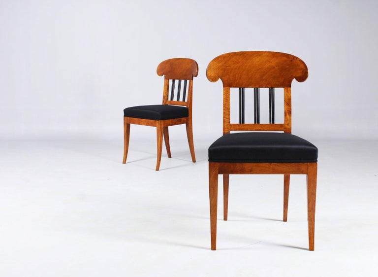 Pair of 19th century shovel chairs  Southern Germany Walnut Biedermeier, circa 1830  Dimensions: height 91 cm, seat height 48 cm  Description: Beautiful pair of walnut Biedermeier chairs. Tapered and slightly flared square legs. Wide,
