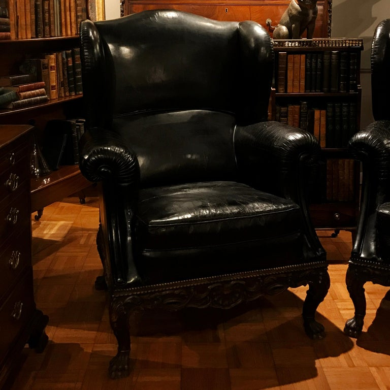 Irish Pair of 19th Century Black Leather Wing Back Armchairs For Sale