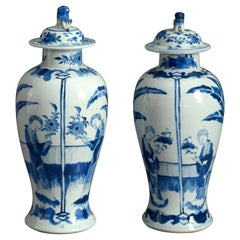 Pair of 19th Century Blue and White Porcelain Vases and Covers in the Kangxi Tas