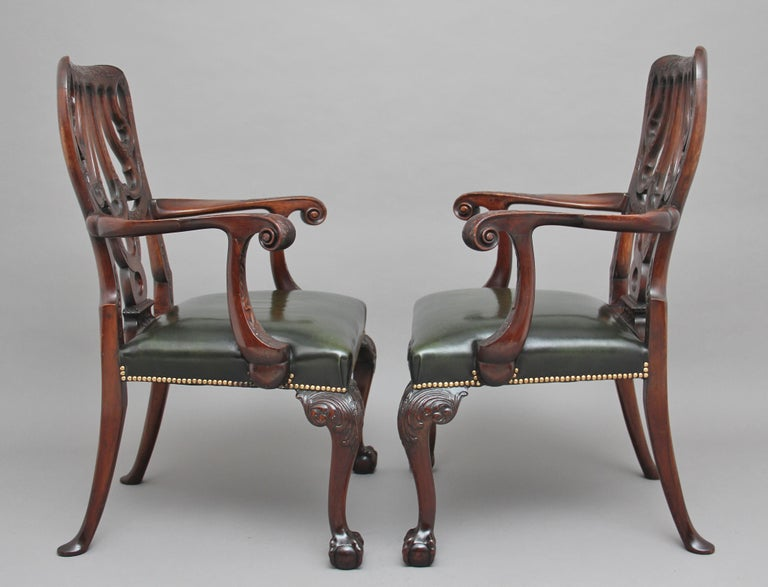 A pair of 19th century carved mahogany armchairs in the Chippendale style, superb quality and lovely dense timber, the supports carved with flower foliage, at the centre is a lovely shaped and carved back splat, the shaped curved arms terminating