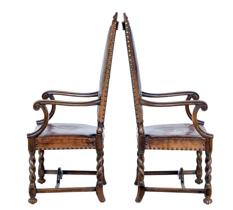 Imposing pair of high back carved oak armchairs, circa 1880.