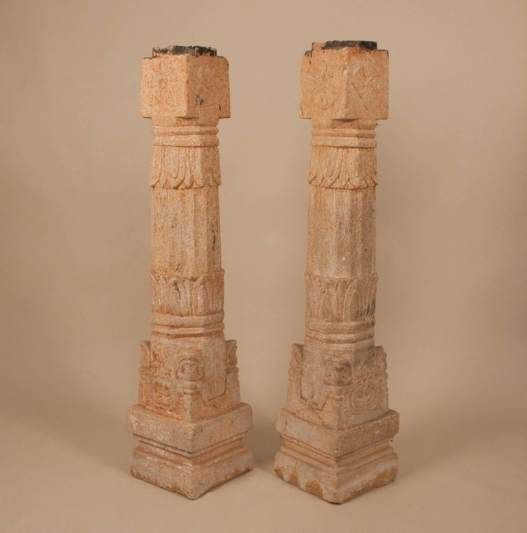 A pair of granite pillars with different carved lotus flower motifs, circa 1850. Standing just 40.25