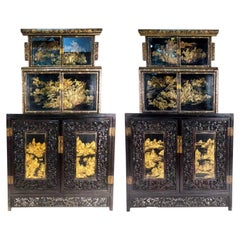 Pair of 20th Century Chinese Black and Gold Lacquered Three-Tiered Cabinets