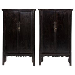 Pair of 19th Century Chinese Black Lacquer Cabinets with Scalloped Aprons