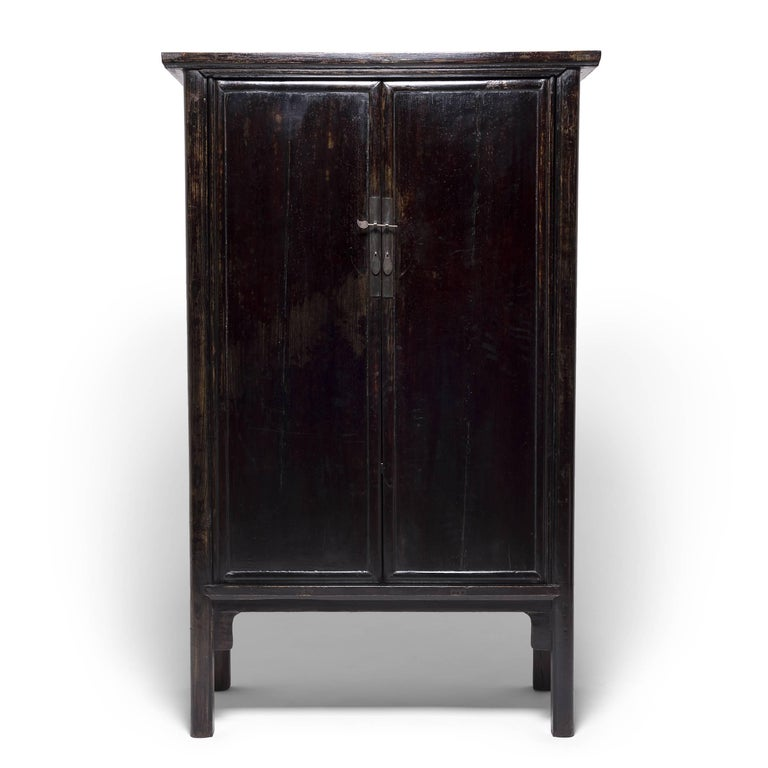 Created in China's Shanxi province, these striking, early 19th century cabinets take their name from their elegant, rounded wood frames. Austere in their simplicity, the cabinets' rich lacquer was hand applied, layer upon layer, to achieve a deep