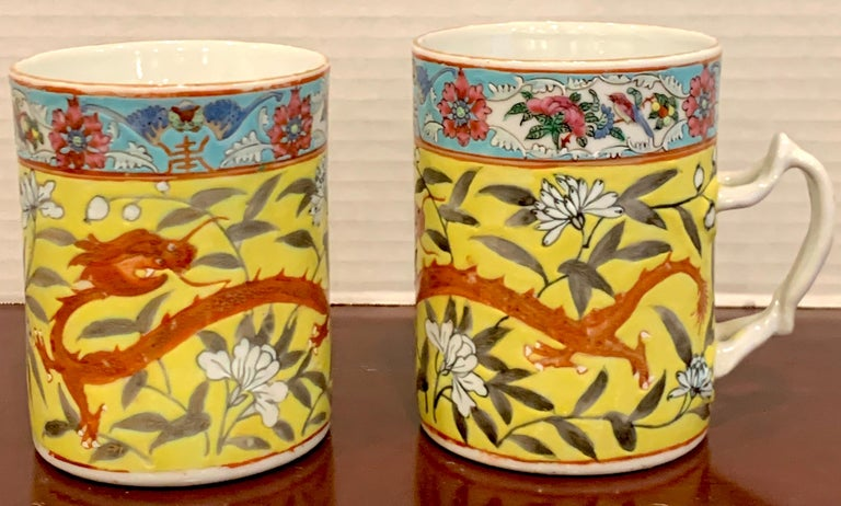 Pair of 19th century Chinese Export Famille Verte yellow Dragon motif mugs, Each one decorated with a four toed dragon within a yellow floral background. Each one measures 4.75