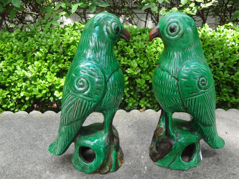 Great pair of 19th century Chinese export glazed pottery or clay birds or parrots. This charming pair of Chinese parrot figures are heavy, well made and executed in a beautiful shade of green. Our parrots are in great condition and would make a