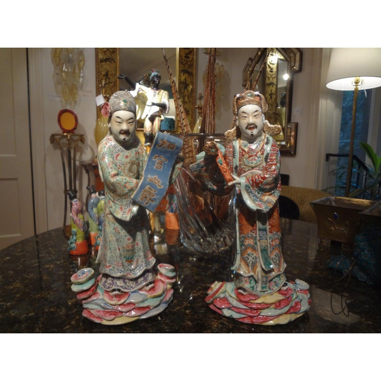 Stunning pair of well executed hand decorated Chinese porcelain figures or sculptures depicting scholars. These fabulous finely detailed figural Chinese statues are from the 19th century.