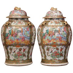 Pair of 19th Century Chinese Porcelain Famille Rose Jars with Foo Dogs Lids