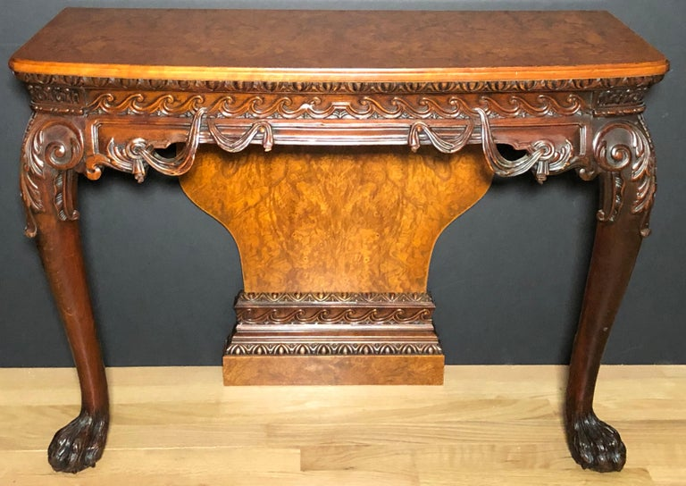 A fine pair 19th century of George II style carved console tables. bookmatched and crossbanded burl wood tops and backs.