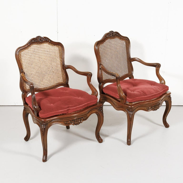 Late 19th Century Pair of 19th Century Country French Louis XV Style Walnut and Cane Armchairs For Sale